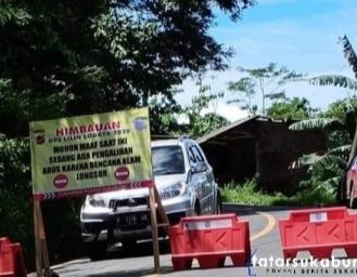 Evakuasi Longsor di Palabuhanratu - Kiaradua Polisi Lakukan Buka Tutup Akses Jalan